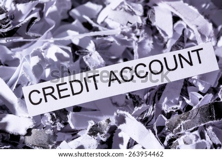 shredded paper tagged with credit account, symbolic photo for data destruction, financing and credit - stock photo