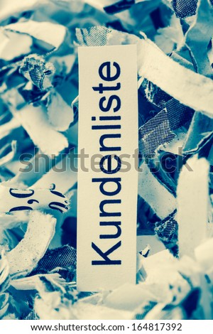 shredded paper tagged with customer lists, symbol photo for customer data and data protection - stock photo