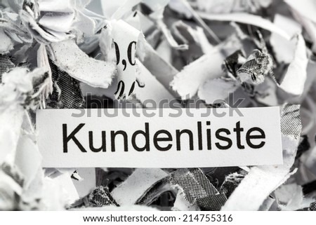 shredded paper tagged with customer lists, symbol photo for customer information and privacy - stock photo