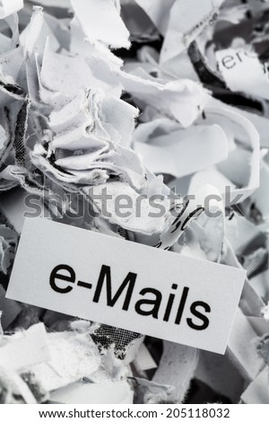 shredded paper tagged with e-mails, symbol photo for data destruction, mails and data flooding - stock photo