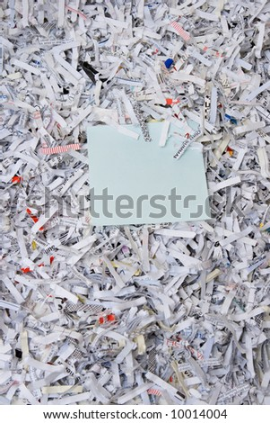Shredded Paper with a blank note - stock photo