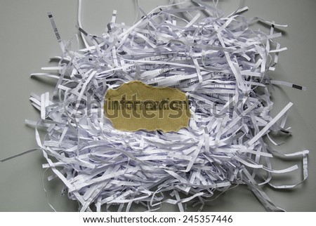 "Shredded paper with piece of brown paper in the center written ""Information"" - stock photo"