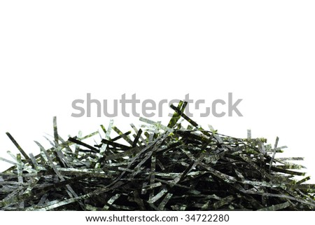 Shreds of dried seaweed, isolated on white with copyspace on the top - stock photo