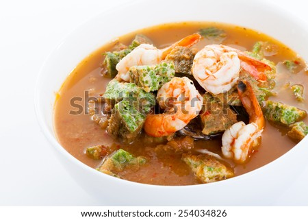 Shrimp and egg sour soup made of tamarind paste, Delicious thai traditional food - stock photo