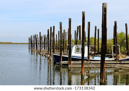 Shrimp and fishing boats at port in the swamp land near New Orleans, Louisiana. - stock photo