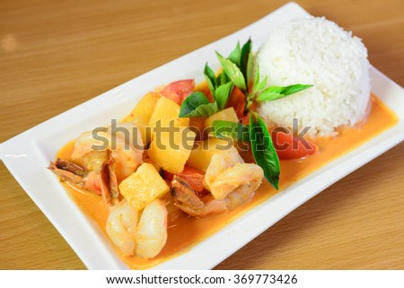 shrimp and pineapple curry with steamed rice - stock photo
