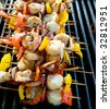 Shrimp and scallop kabobs on grill - stock photo