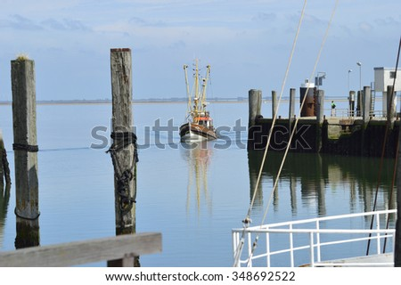 Shrimp boat returns from the sea - stock photo