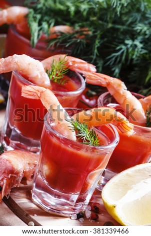 Shrimp cocktail in small glasses, cherry tomatoes, dill, parsley and lemon with salt and spices, selective focus on shrimp - stock photo
