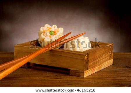 shrimp dim sum with chopstick - stock photo