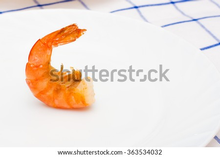shrimp fried in oil laid out on a white plate - stock photo