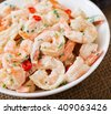 Shrimp in a creamy garlic sauce with parsley and lime in white bowl - stock photo