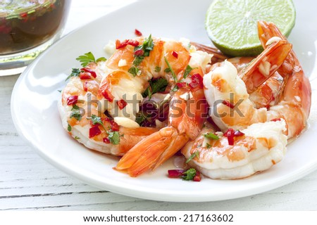 Shrimp or prawns with chili and lime dipping sauce. - stock photo