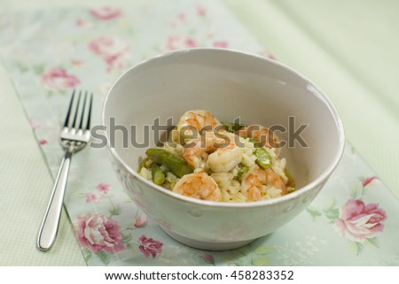 Shrimp risotto with asparagus. - stock photo