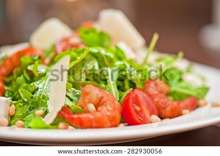 shrimp salad with cheese and arugula - stock photo