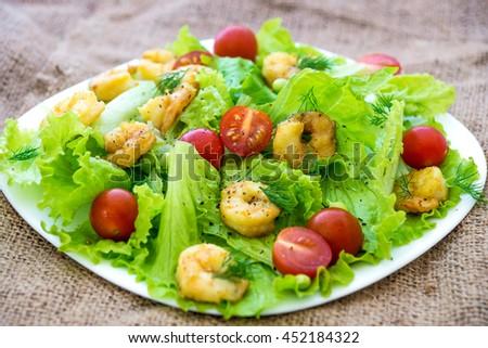 Shrimp salad with cherry tomatoes - stock photo