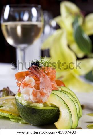 Shrimp salad with fruit and white wine - stock photo