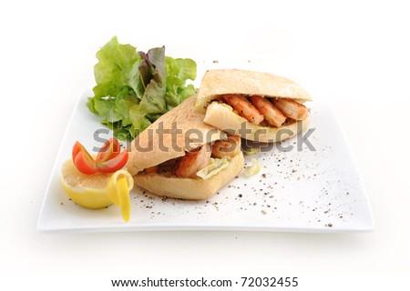 Shrimp sandwich with lettuce, tomatoes and lemon slices - stock photo