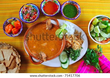 shrimp seafood soup mexican chili sauces and nachos - stock photo