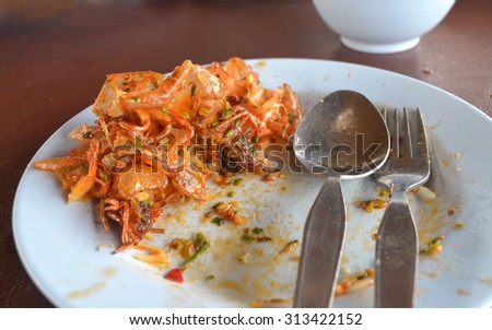 Shrimp shell fragments food on dish after partying - stock photo