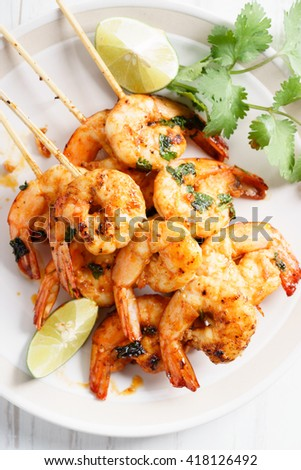 shrimp sriracha kebabs with lime and cilantro leaves
