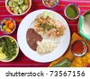 shrimp tacos rice and frijoles chili sauces Mexican seafood - stock photo