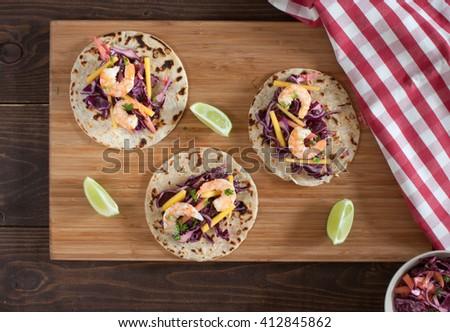 Shrimp tacos with mango slaw - stock photo