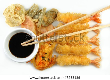 Shrimp Vegetable Tempura and chopsticks on a white plate. - stock photo