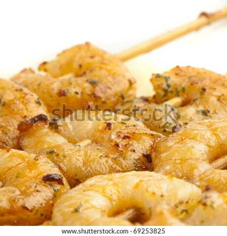 shrimp with garlic on a plate, closeup photo