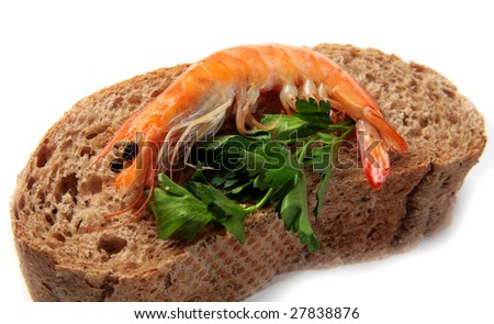 shrimp with herbs and bread - stock photo