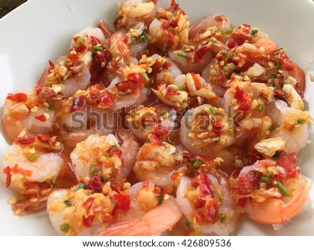 Shrimp with lemon and Spicy on white plate