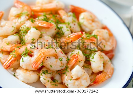 shrimps cooked with garlic and dill - stock photo