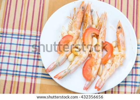 shrimps cooked with garlic and tomato - stock photo