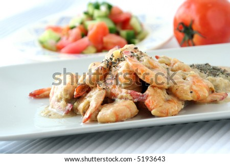 Shrimps dish with sauce & salad - stock photo