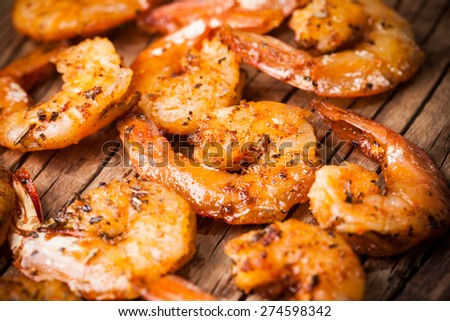 Shrimps fried on a wooden background - stock photo