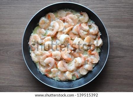 Shrimps in pan - stock photo