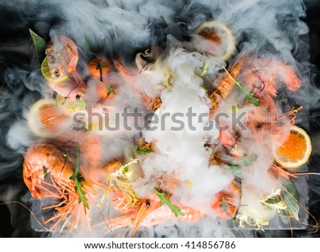 shrimps on stone plate - stock photo