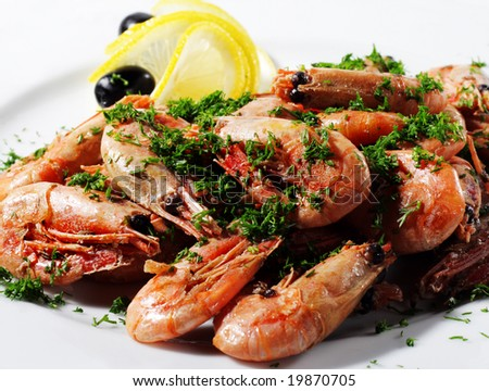 Shrimps Plate Served with Lemon and Olives - stock photo
