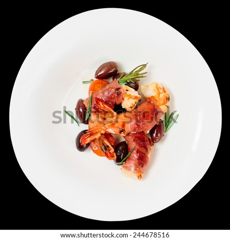 Shrimps with bacon, olives and rosemary in plate, isolated on black - stock photo