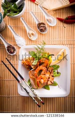 shrimps with fish and vegetables - stock photo