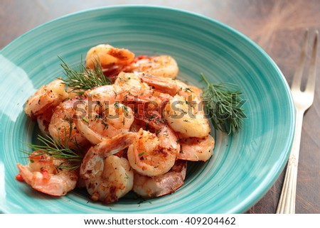 Shrimps with fresh dill served on a plate