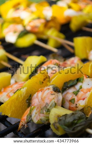 Shrimps with orange on barbeque