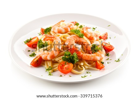 Shrimps with pasta and vegetables  - stock photo