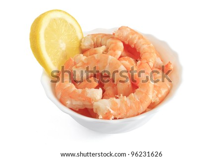 shrimps with sliced lemon in a bowl isolated on white with clipping path - stock photo