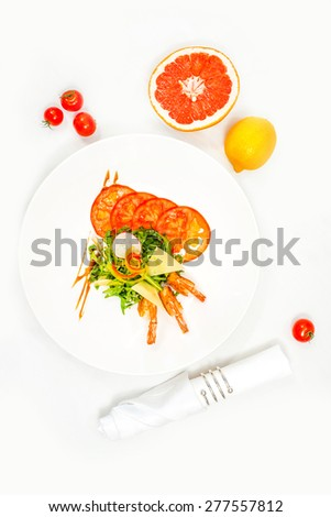 Shrimps with vegetables and cheese on white plate in the restaurant. - stock photo