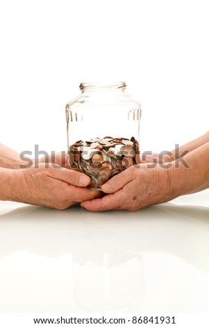 Shrinking value of retirement fund concept with senior hands holding savings - stock photo