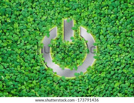 shut Down button on green leaf background - stock photo