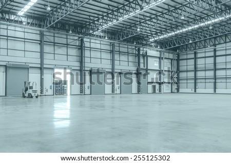 Shutter door inside factory and Empty warehouses. - stock photo