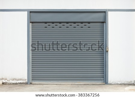 Shutter door or roller door and concrete floor outside factory building use for industrial background.