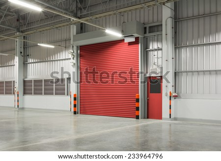 Shutter door or rolling door red color, night scene. - stock photo